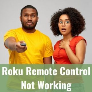 Black couple standing next to each other with man holding TV remote